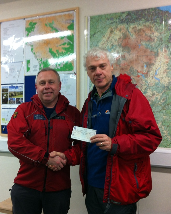 Alun Saunders from the Bray Strollers handing over a cheque for €750 to Derry Cullen, the Glen of Imaal MRT Team Leader